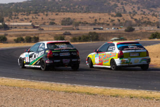 Brett Garland and Louis Scholtz fight for the lead